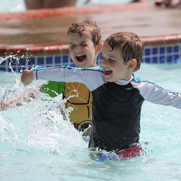 Two boys swimming in the pool at a summer day camp in Baltimore County.