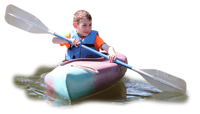 Young boy boating at Beth Tfiloh's Summer Camp.