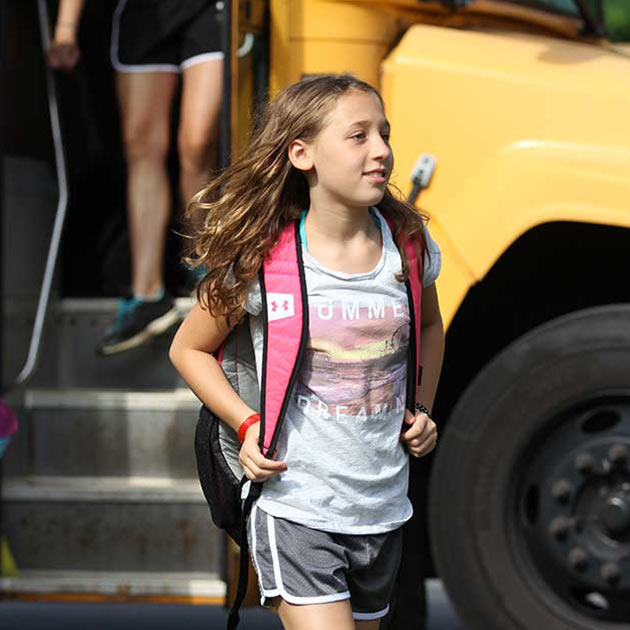 Girl getting of bus at BT Camps in Reisterstown.